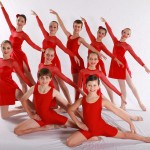 dancers in red leotards