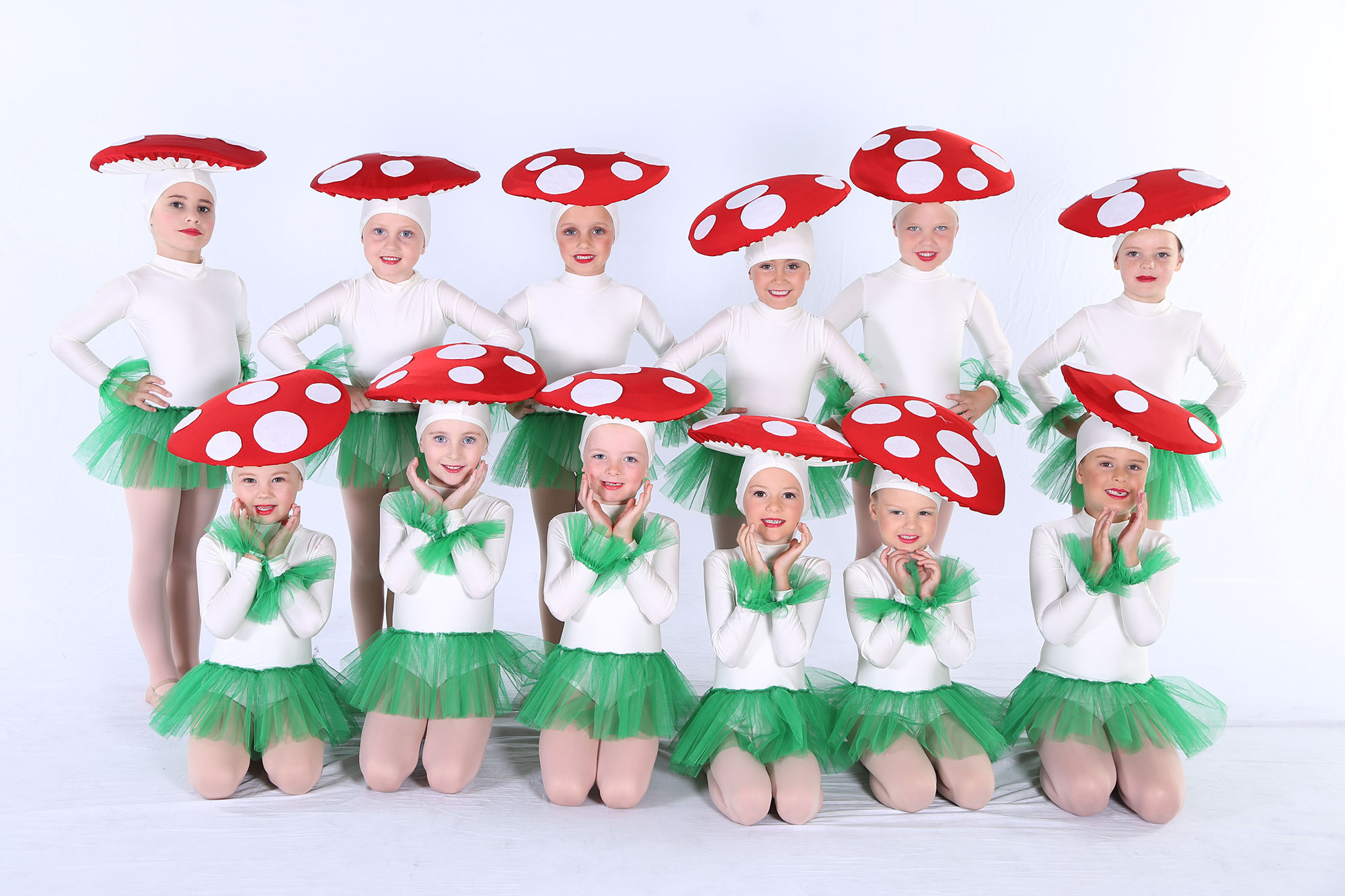 dancers dressed as mushrooms