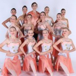 dancers in peach outfits