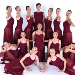 dancers in maroon outfits