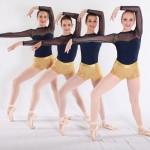 dancers in gold and black leotards